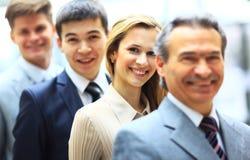 Glückliches lächelndes Geschäftsteam Stockfoto