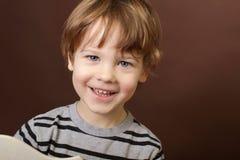 Glückliches lächelndes Kind Lizenzfreie Stockfotos
