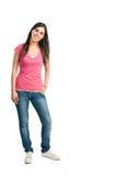 Glückliches lächelndes lateinisches Mädchen in voller Länge Stockfotos
