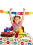 Glückliches Mädchen auf Geburtstagsfeier Stockfotos