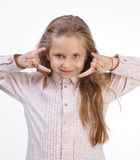 Glückliches Mädchen, das Rock-and-Rollzeichen macht Lizenzfreies Stockbild