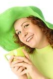 Glückliches Mädchen mit einer Tasse Tee stockfotos