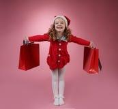 Glückliches Mädchen mit Einkaufstasche Lizenzfreies Stockfoto