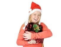 Glückliches Mädchen mit Geschenk Stockfoto