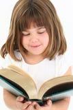 Glückliches Mädchen mit großem Buch lizenzfreies stockbild