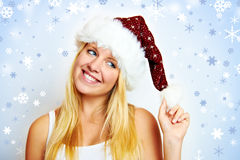 Glückliches Mädchen mit Sankt-Hut Stockbild