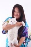 Glückliches Mädchen und Katze Stockfoto