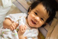 Glückliches Mädchenbaby Stockbilder