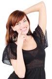 Glückliches Mädchenlächeln und berührt ihr Kinn Lizenzfreie Stockbilder
