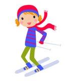 Glückliches Mädchenskifahren auf einer Steigung Lizenzfreie Stockfotografie