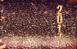 Glückliches neues 2017-jähriges im Weinlesefarbzusammenfassungs-Funkelnhintergrund Stockbild