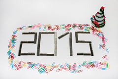 Glückliches neues 2015-jähriges mit Heftklammern Stockfoto