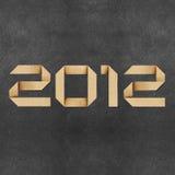 Glückliches neues Jahr 2012 bereitete Papierfertigkeit auf Stockbild