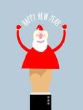 Glückliches neues Jahr Geschäftsmannhandmanipulation Puppenarm Santa Cla Stockfoto