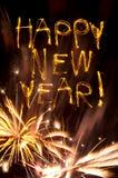 Glückliches neues Jahr Sparklers mit Goldfeuerwerken lizenzfreie stockfotos