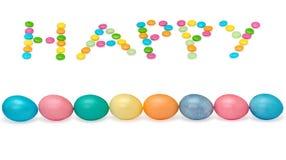 Glückliches Ostern-Bild mit acht Eiern und candys Lizenzfreies Stockbild