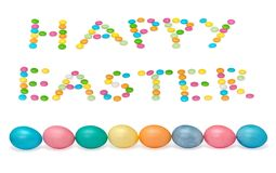 Glückliches Ostern-Bild mit acht Eiern und candys Lizenzfreie Stockbilder