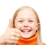 Glückliches positives blondes Mädchen im orange sweate Lizenzfreies Stockbild