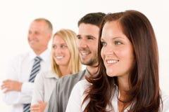 Glückliches Profil des Geschäftsteams, das beiseite schaut Lizenzfreies Stockbild