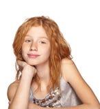 Glückliches Redheadmädchen auf Weiß Lizenzfreie Stockfotografie