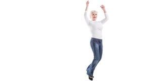 Glückliches reifes Frauenspringen Lizenzfreie Stockfotografie