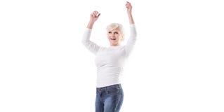 Glückliches reifes Frauenspringen Stockfotos