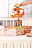 Glückliches Schätzchen mit Spielzeug Lizenzfreie Stockfotografie