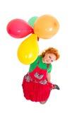 Glückliches schönes Mädchenflugwesen mit baloons lizenzfreies stockfoto