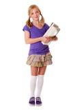 Glückliches Schulemädchen mit Büchern Lizenzfreies Stockfoto