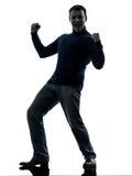 Glückliches starkes siegreiches Schattenbild des Mannes in voller Länge Lizenzfreies Stockbild