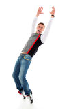 Glückliches Tanzen des jungen Mannes Lizenzfreie Stockfotos