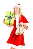 Glückliches weibliches Weihnachten Sankt mit Geschenk und Schuhen Stockbild