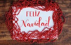 Glückliches Weihnachten, Mitteilung auf spanisch lizenzfreie stockfotografie