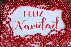 Glückliches Weihnachten, Mitteilung auf spanisch lizenzfreies stockfoto
