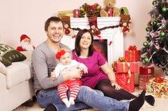 Glückliches Weihnachtsfamilie Stockbilder