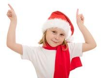 Glückliches Weihnachtskind zeigt seinen Finger aufwärts Stockfotos