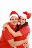 Glückliches Weihnachtspaare getrennt lizenzfreie stockbilder