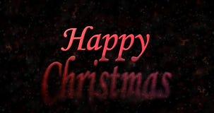 Glückliches Weihnachtstext wendet sich an Staub von der Unterseite auf schwarzem backgrou Lizenzfreies Stockbild