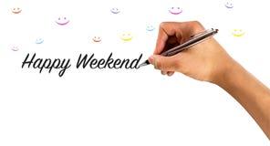 Glückliches Wochenende mit Handschrift- und smileygesichtern in vielen Farben, stockfotografie