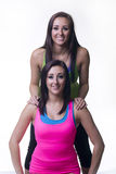 Glückliches Zwillingsschwesterlächeln Lizenzfreie Stockfotos