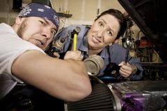Glücklose Mechaniker stockfotografie