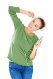 Glückselige Frau, die Musik tanzt und hört Lizenzfreies Stockbild