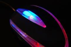 Glühen in der dunklen Maus Stockfoto