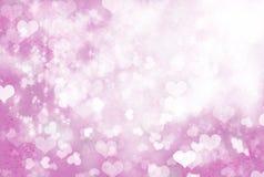 Glühen der Liebe - Scheinherzhintergrund Stockfotos