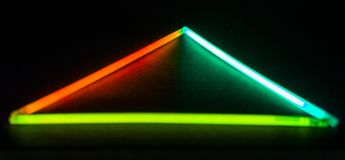 Glühen-Stock-Dreieck lizenzfreie stockbilder