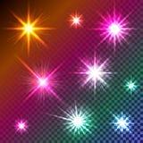 Glühende funkelnde Sterne auf transparentem farbigem Hintergrund Stockfotografie