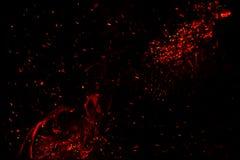 Glühende Funken auf einem schwarzen Hintergrund Lizenzfreies Stockbild