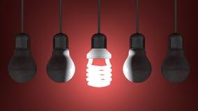Glühende gewundene Glühlampe unter totem Wolfram eine, die am Rot hängen stock abbildung