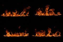 Glühende orange Flammen auf Schwarzem Lizenzfreies Stockbild