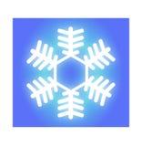Glühende weiße Schneeflocke Stockfotos